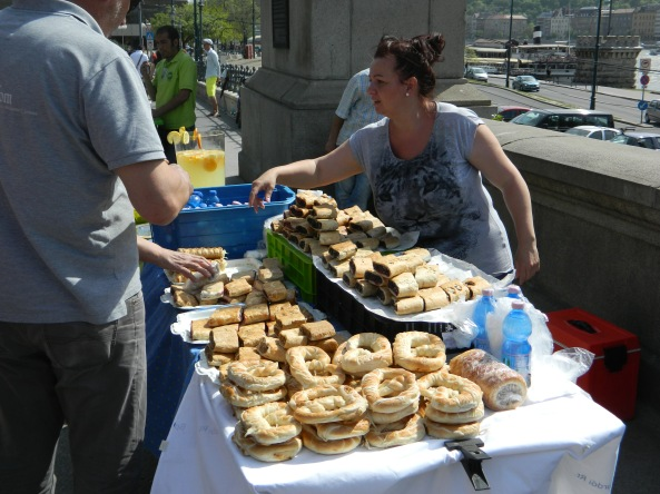 Vendor Selling Pastries, Strudels On the Riverbank