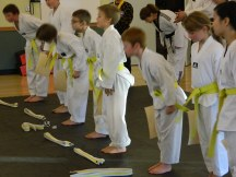 Bowing to parents after gaining yellow belt.